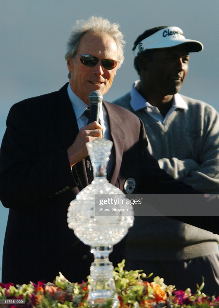 <a gi-track='captionPersonalityLinkClicked' href=/galleries/search?phrase=Clint+Eastwood&family=editorial&specificpeople=201795 ng-click='$event.stopPropagation()'>Clint Eastwood</a> presents the winners trophy to <a gi-track='captionPersonalityLinkClicked' href=/galleries/search?phrase=Vijay+Singh&family=editorial&specificpeople=179484 ng-click='$event.stopPropagation()'>Vijay Singh</a> at the final round of the PGA Tour's 2004 AT&T Pebble Beach National Pro-Am at Pebble Beach Golf Links February 8, 2004.
