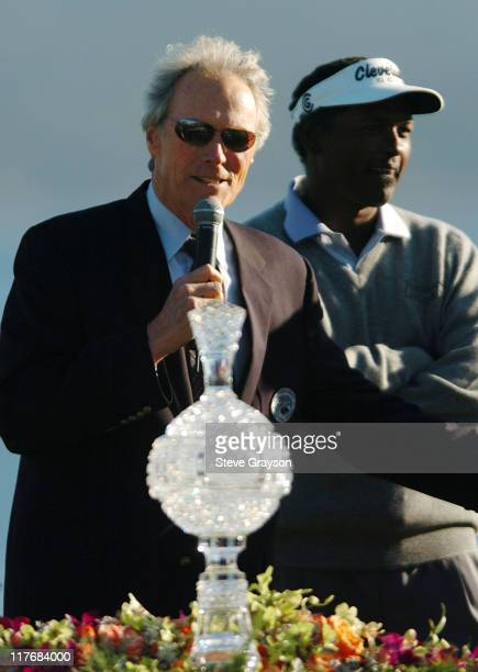 Clint Eastwood presents the winners trophy to Vijay Singh at the final round of the PGA Tour's 2004 ATT Pebble Beach National ProAm at Pebble Beach...