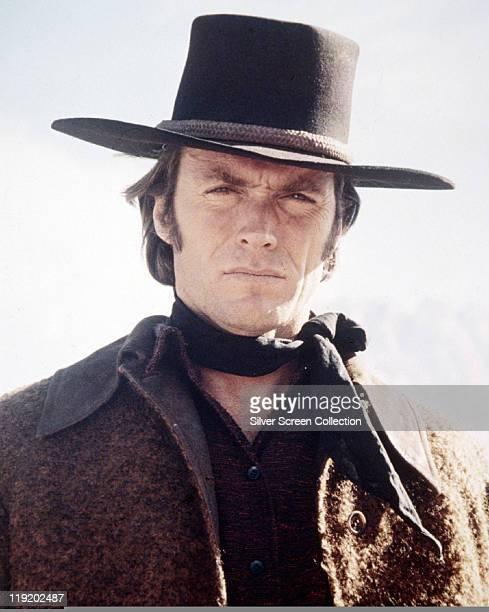Clint Eastwood US actor and film director wearing a cowboy hat black neckerchief and brown coat in a publicity portrait issued for the film 'Pale...
