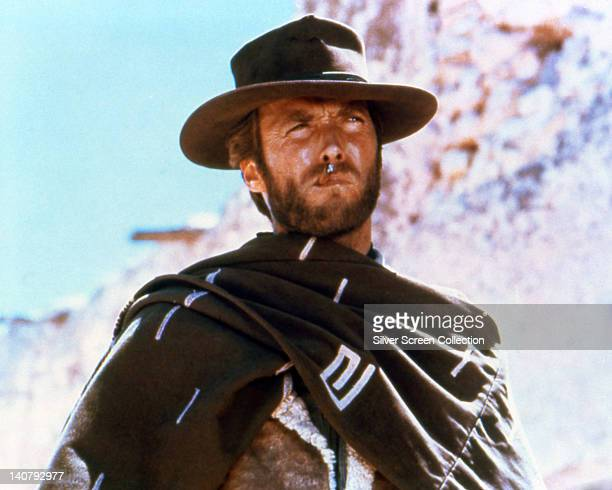Clint Eastwood US actor smoking a cigar wearing a brown hat and poncho in a publicity portrait issued for the film 'A Fistful of Dollars' Spain 1964...