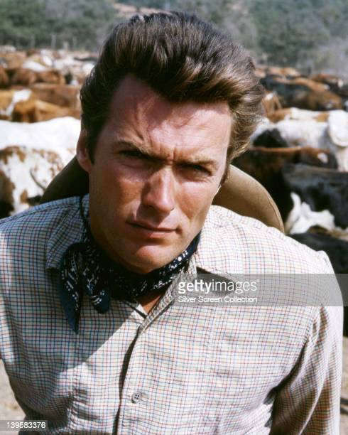 Clint Eastwood US actor wearing a fine check shirt and blue neck scarf in a publicity portrait issued for the US television series 'Rawhide' USA...