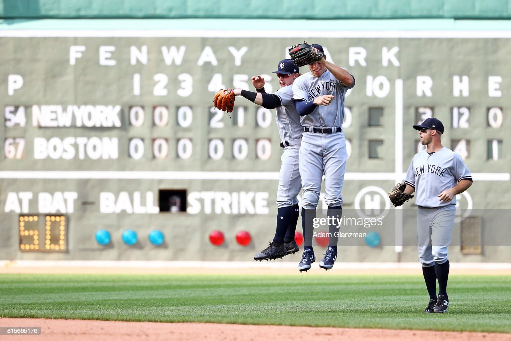 Clint Frazier #30, Aaron Judge #99 and Brett Gardner #11 of the New York Yankees react after the victory in game one of a doubleheader against the Boston Red Sox at Fenway Park on July 16, 2017 in Boston, Massachusetts.