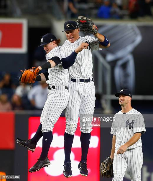 Clint Frazier Aaron Judge and Brett Gardner of the New York Yankees celebrate after defeating the Cincinnati Reds at Yankee Stadium on July 25 2017...