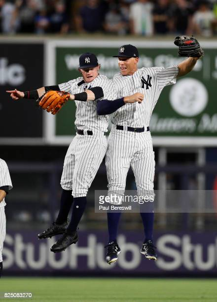 Clint Frazier and Aaron Judge of the New York Yankees leap in the air celebrating after the game as both players hit home runs in tonight's MLB...