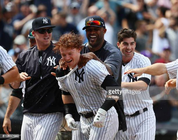 Clint Frazier of the New York Yankees celebrates a three run walk off home run in the ninth inning against the Milwaukee Brewers with a 53 win during...
