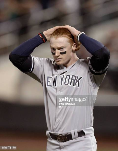 Clint Frazier of the New York Yankees holds his head after making an out during an MLB baseball game against the Tampa Bay Rays on September 12 2017...