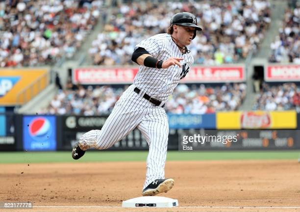 Clint Frazier of the New York Yankees rounds third and heads for home in the seventh inning against the Cincinnati Reds on July 26 2017 at Yankee...