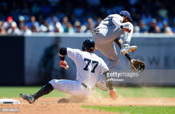 Clint Frazier of the New York Yankees steals second base in the first inning as Tim Beckham of the Tampa Bay Rays can't come up with the ball at...