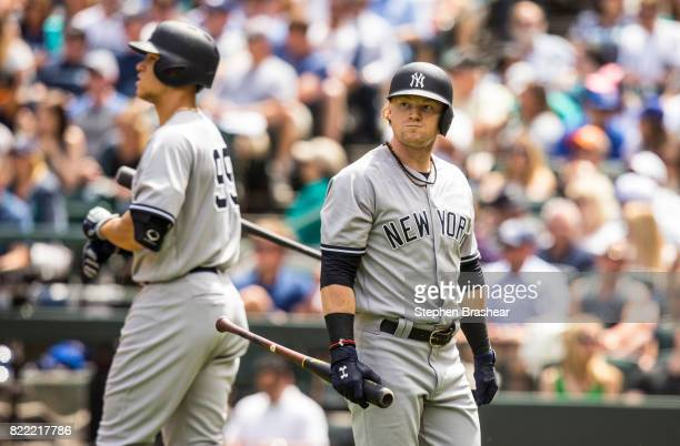 Clint Frazier of the New York Yankees walks off the field past Aaron Judge of the New York Yankees after an atbat in a game against the Seattle...