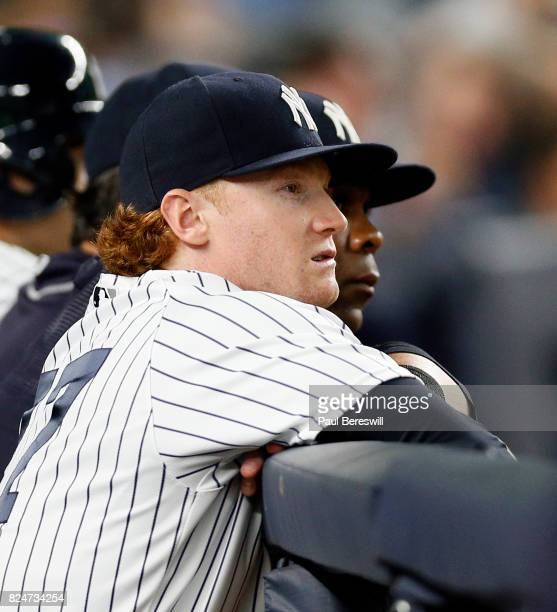Clint Frazier of the New York Yankees watches from the dugout railing in an MLB baseball game against the Tampa Bay Rays on July 27 2017 at Yankee...