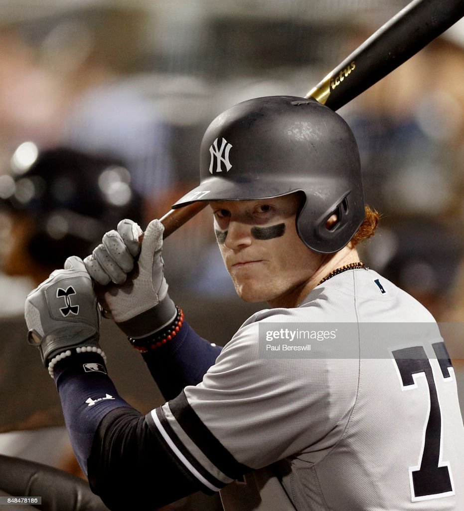 Clint Frazier #77 of the New York Yankees works on his stance as he waits at the top of the dugout to bat during an MLB baseball game against the Tampa Bay Rays on September 12, 2017 at CitiField in the Queens borough of New York City. This game was scheduled to be played in Tampa Bay, but had to be moved to play in a neutral stadium because of hurricane damage in Florida. Rays won 2-1.