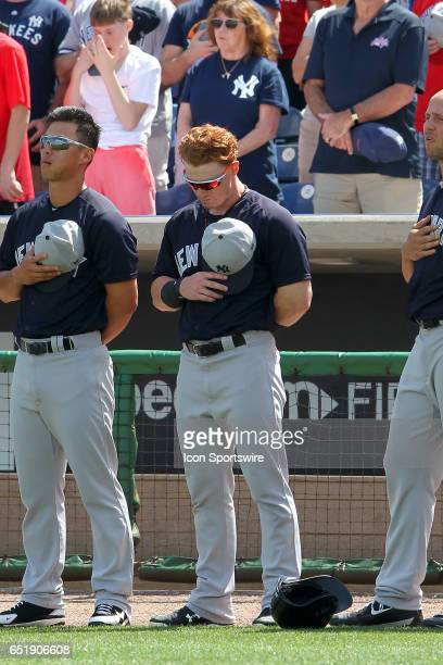 Clint Frazier of the Yankees showing his freshly cut hair stands with his hand over his heart during the playing of the National Anthem before the...