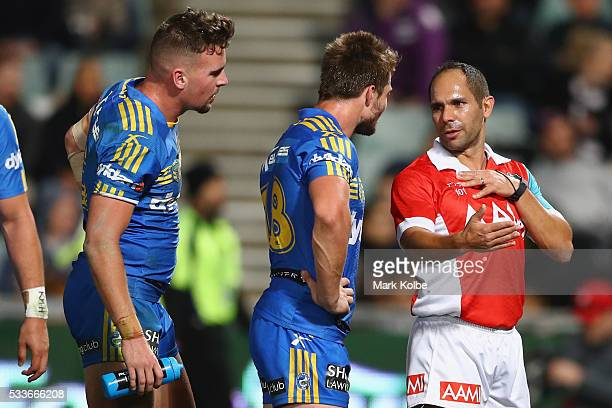 Clint Gutherson and Kieran Foran of the Eels speak to referee Ashley Klein during the round 11 NRL match between the Parramatta Eels and the...