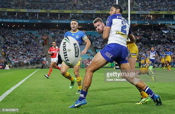 Clint Gutherson of the Eels and Curtis Rona of the Bulldogs compete for the ball during the round three NRL match between the Canterbury Bulldogs and...