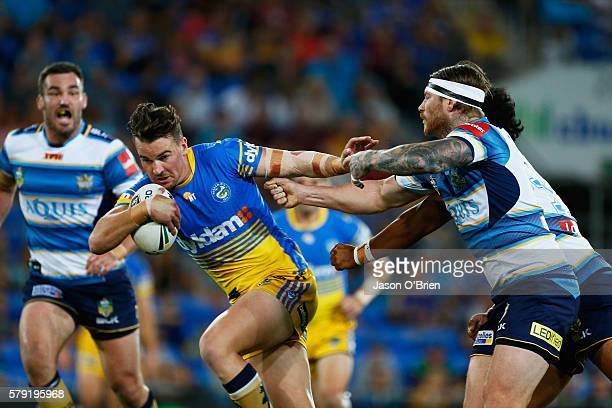 Clint Gutherson of the Eels breaks through the defence during the round 20 NRL match between the Gold Coast Titans and the Parramatta Eels at Cbus...