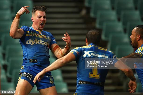 Clint Gutherson of the Eels celebrates scoring a try with team mates during the round 18 NRL match between the Parramatta Eels and the Sydney...