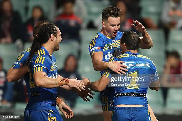 Clint Gutherson of the Eels congratulates team mate Michael Gordon of the Eels after scoring a try during the round 18 NRL match between the...