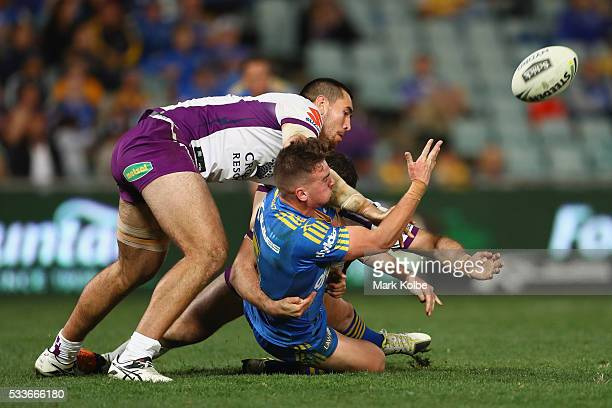 Clint Gutherson of the Eels passes as he is tackled during the round 11 NRL match between the Parramatta Eels and the Melbourne Storm at Pirtek...
