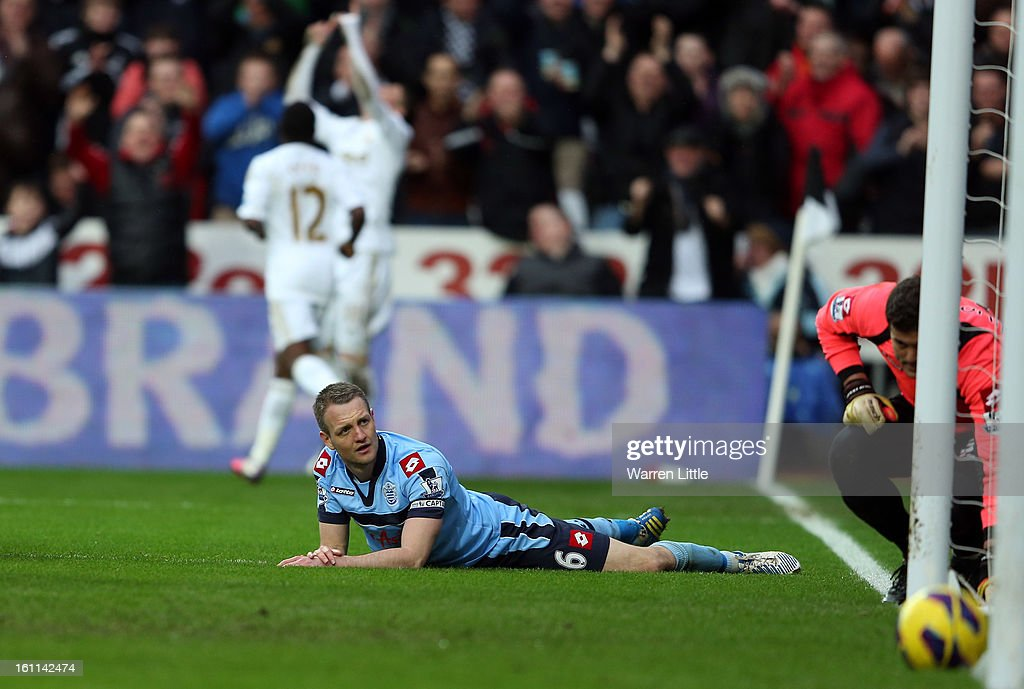 Clint Hill, Captain of Queens Park Rangers looks on after conceding a goal during the Premier League match between Swansea City and Queens Park Rangers at Liberty Stadium on February 9, 2013 in Swansea, Wales.
