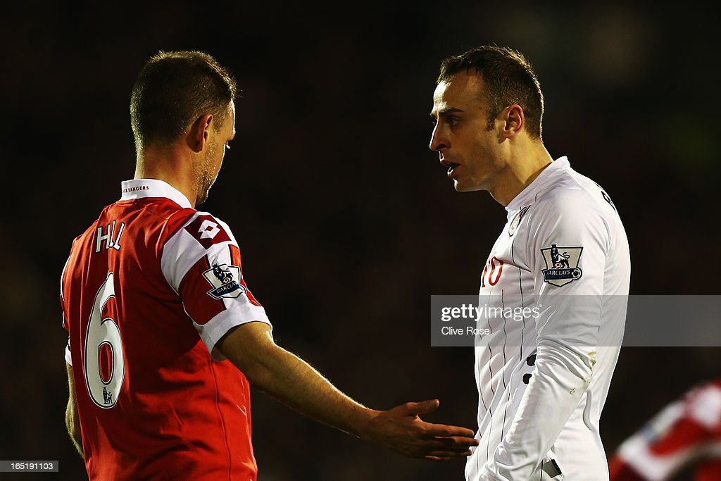 Clint Hill of Queens Park Rangers and <a gi-track='captionPersonalityLinkClicked' href=/galleries/search?phrase=Dimitar+Berbatov&family=editorial&specificpeople=216379 ng-click='$event.stopPropagation()'>Dimitar Berbatov</a> of Fulham face up during the Barclays Premier League match between Fulham and Queens Park Rangers at Craven Cottage on April 1, 2013 in London, England.