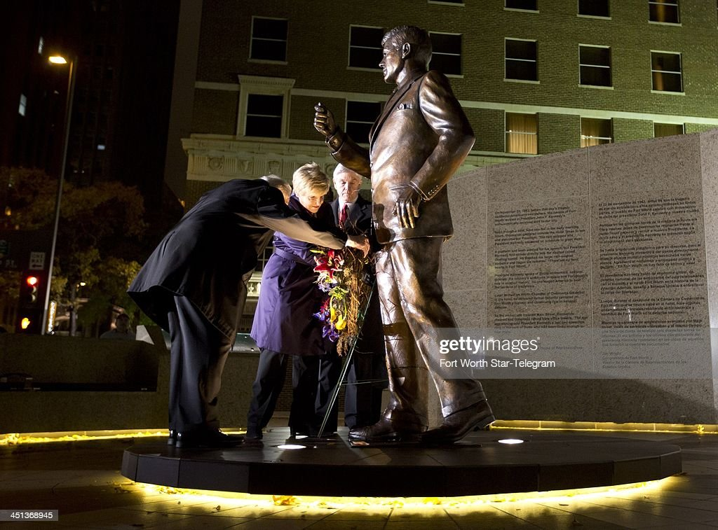 Clint Hill, who served on Jacqueline Kennedy's Secret Service detail, Fort Worth Mayor Betsy Price and Congressman Roger Williams place a wreath outside the Hilton hotel in Fort Worth, Texas, at a tribue to President John F. Kennedy on Friday, Nov. 22, 2013, marking the 50th anniversary of his death.