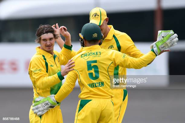 Clint Hinchliffe of CAXI celebrates taking the wicket of Daniel Hughes of NSW during the JLT One Day Cup match between New South Wales and the...