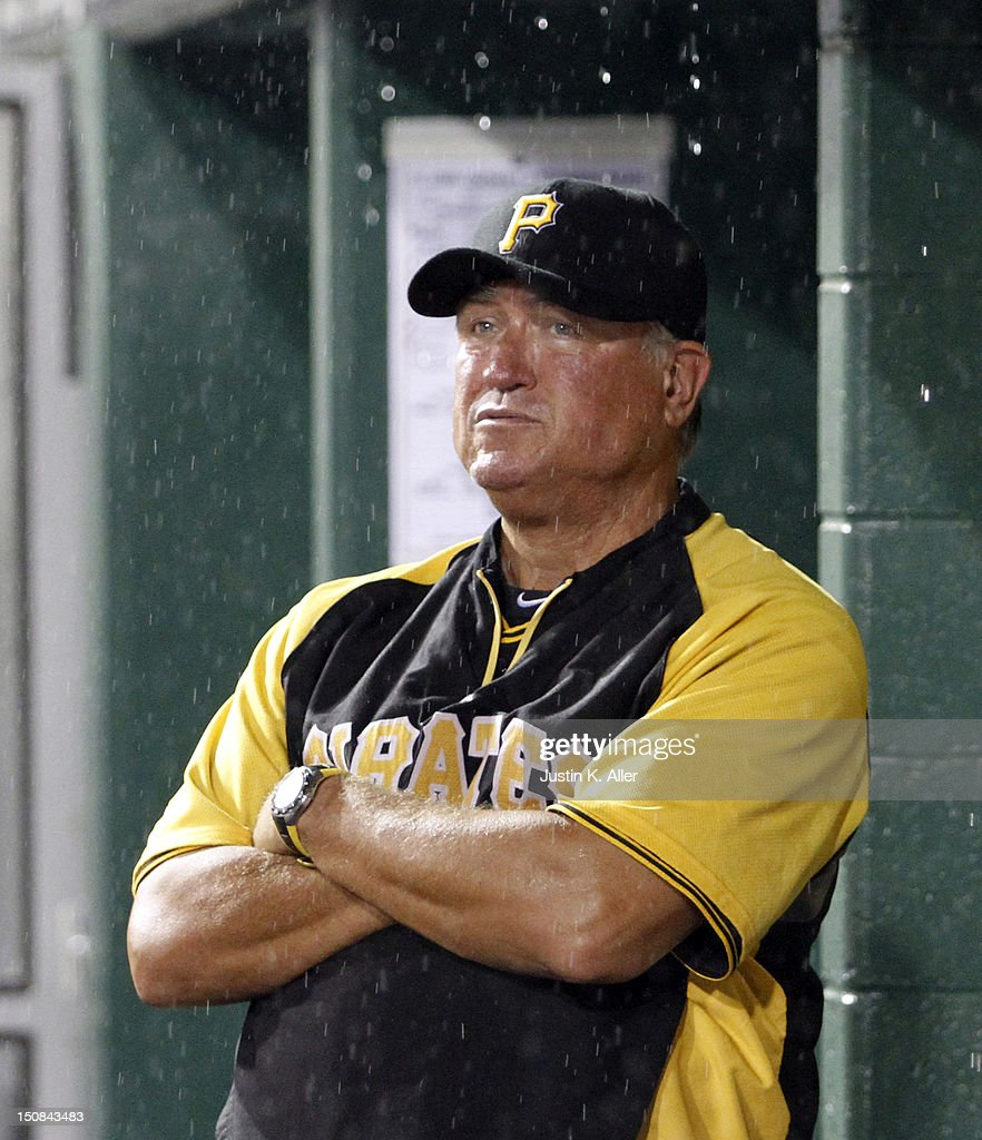 Clint Hurdle #13 looks on during a rain delay against the St. Louis Cardinals during the game on August 27, 2012 at PNC Park in Pittsburgh, Pennsylvania.