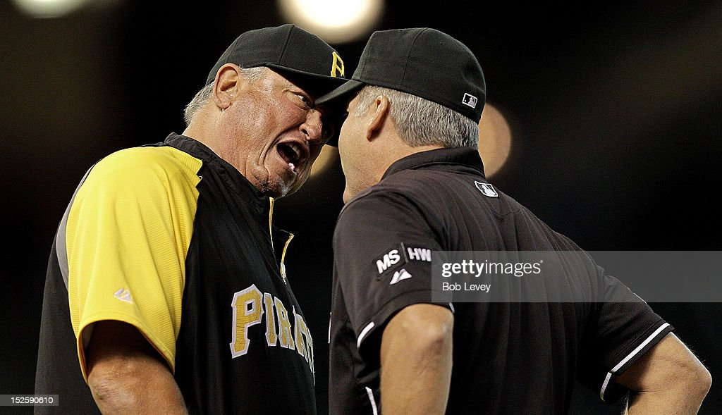 Clint Hurdle #13 of the Pittsburgh Pirates argues with first base umpire Tim Timmons after he was ejected from the game after the umpire crew reversed a call at first base from safe to out during a game against the Houston Astros at Minute Maid Park on September 22, 2012 in Houston, Texas.