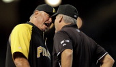Clint Hurdle of the Pittsburgh Pirates argues with first base umpire Tim Timmons after he was ejected from the game after the umpire crew reversed a...