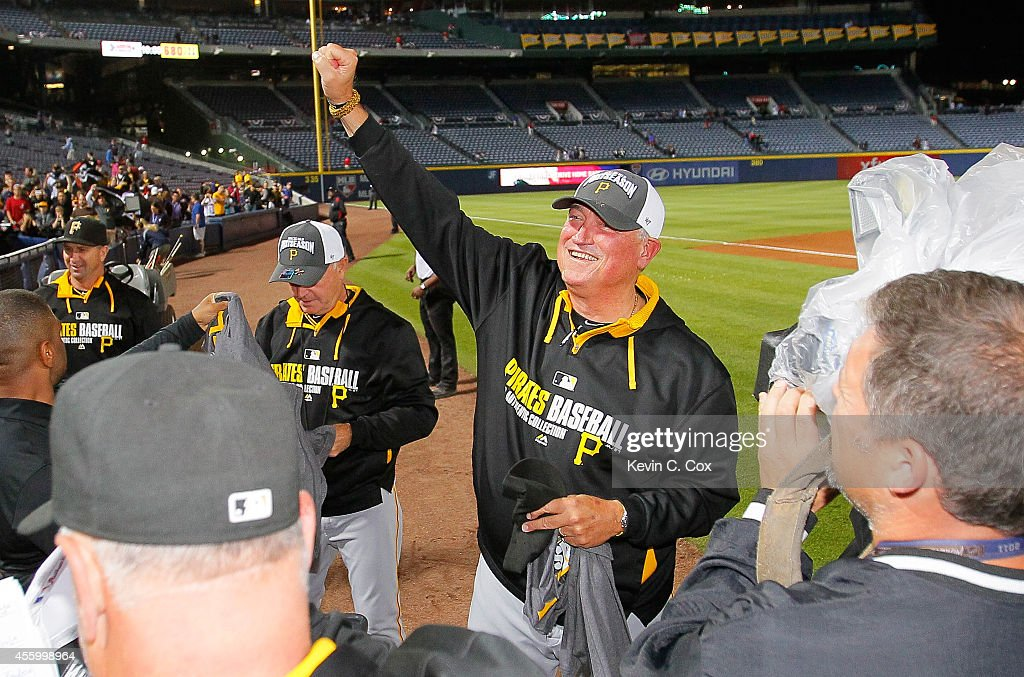 Clint Hurdle of the Pittsburgh Pirates celebrates clinching a National League playoff spot after their 32 win over the Atlanta Braves at Turner Field...