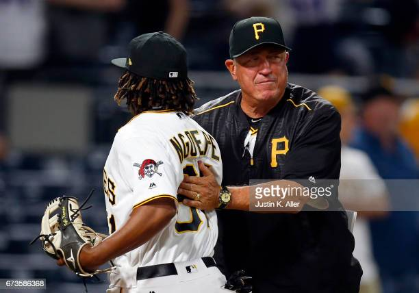 Clint Hurdle of the Pittsburgh Pirates celebrates with Gift Ngoepe after defeating the Chicago Cubs 65 at PNC Park on April 26 2017 in Pittsburgh...