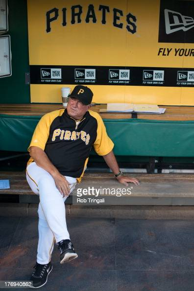 Clint Hurdle of the Pittsburgh Pirates is seen in the dugout during the game against the St Louis Cardinals at PNC Park on July 29 2013 in Pittsburgh...