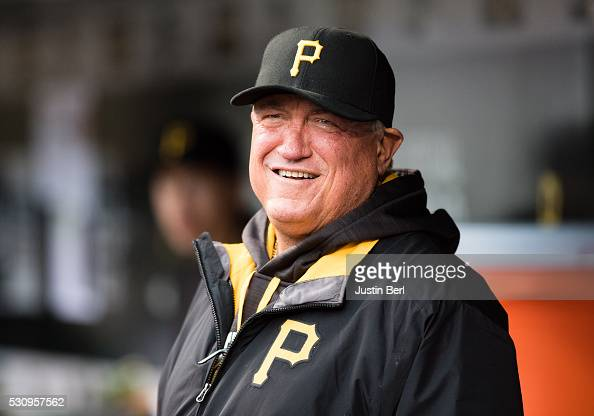 Clint Hurdle of the Pittsburgh Pirates looks on from the dugout before the game against the Chicago Cubs at PNC Park on May 2 2016 in Pittsburgh...