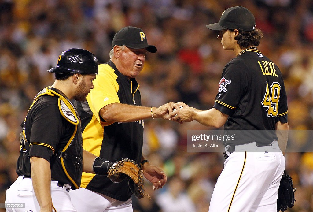 <a gi-track='captionPersonalityLinkClicked' href=/galleries/search?phrase=Clint+Hurdle&family=editorial&specificpeople=223975 ng-click='$event.stopPropagation()'>Clint Hurdle</a> #13 of the Pittsburgh Pirates takes Jeff Locke #49 out of the game in the sixth inning against the Miami Marlins during the game on August 6, 2013 at PNC Park in Pittsburgh, Pennsylvania.
