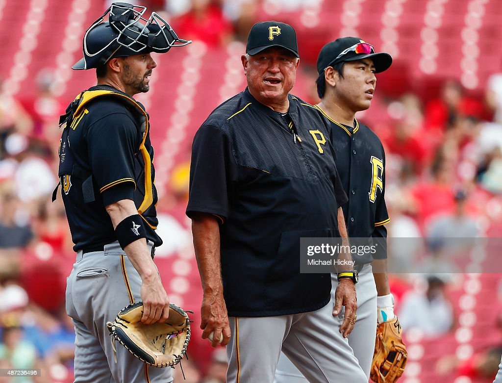 Clint Hurdle of the Pittsburgh Pirates visits the mound in the sixth inning against the Cincinnati Reds at Great American Ball Park on September 7...
