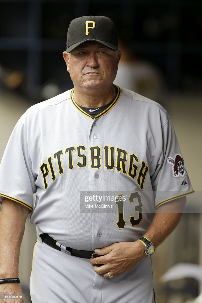 Clint Hurdle #13 of the Pittsburgh Pirates walks the dugout before the start of the game against the Milwaukee Brewers at Miller Park on September 01, 2012 in Milwaukee, Wisconsin.