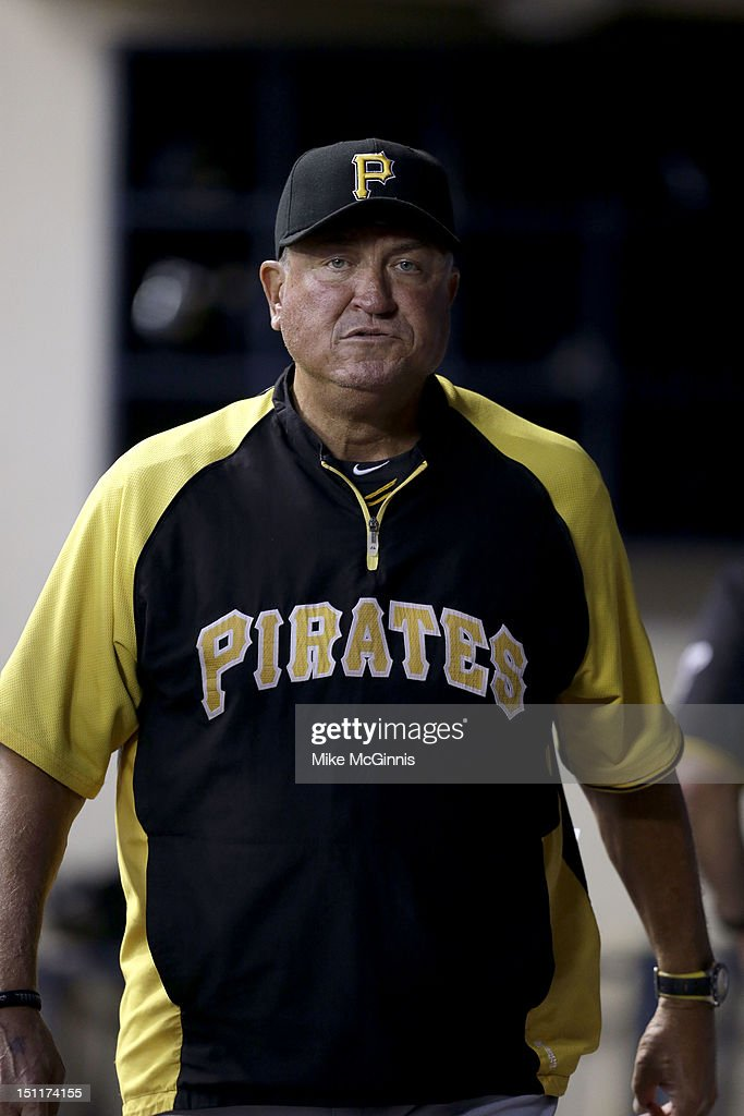 Clint Hurdle #13 of the Pittsburgh Pirates walks the dugout during the game against the Milwaukee Brewers at Miller Park on August 31, 2012 in Milwaukee, Wisconsin.