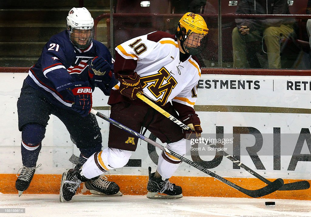 Clint Lewis #21 of United States U-18 tries to take the puck from Ben Marshall #10 of the University of Minnesota October 26, 2012 at Mariucci Arena in Minneapolis, Minnesota.