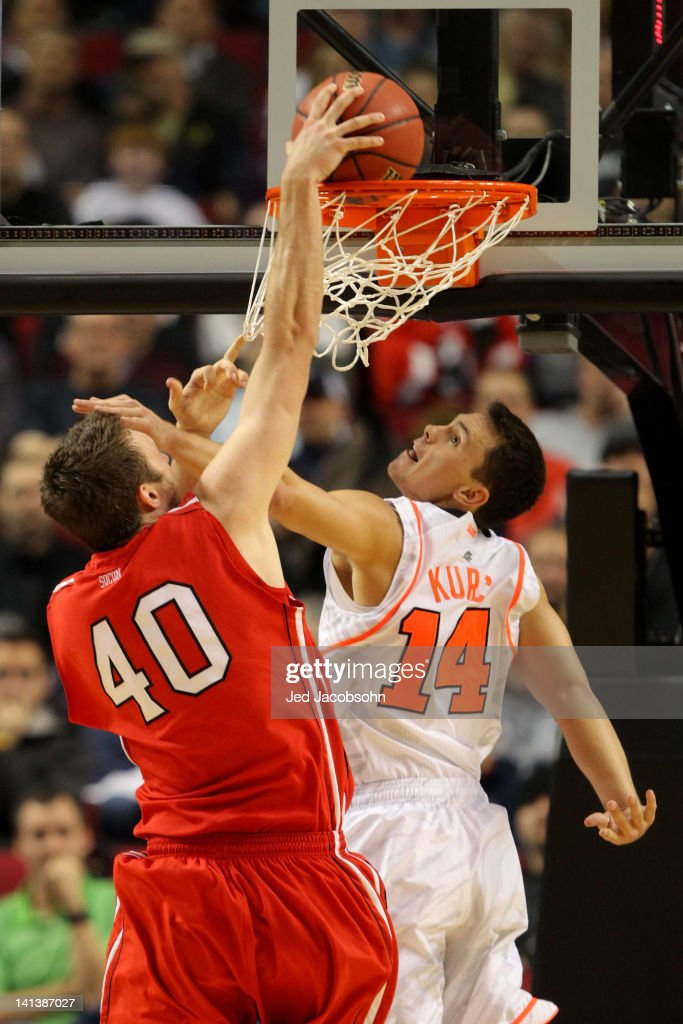 Clint Mann #40 of the Davidson Wildcats dunks over Kyle Kuric #14 of the Louisville Cardinals in the second half in the second round of the 2012 NCAA men's basketball tournament at Rose Garden Arena on March 15, 2012 in Portland, Oregon.