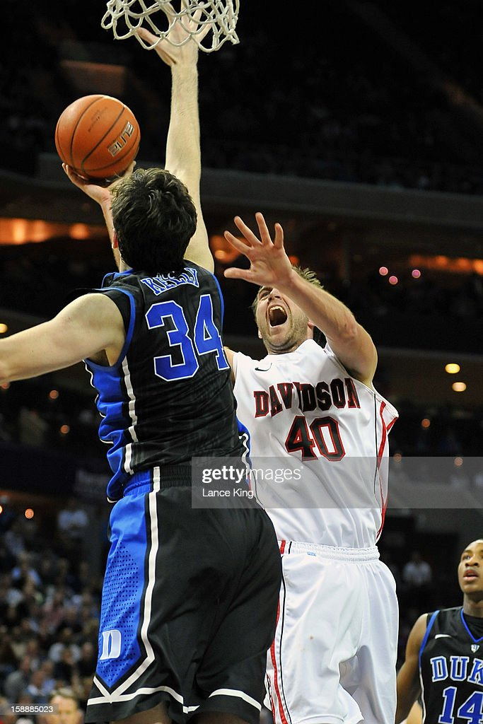 Clint Mann #40 of the Davidson Wildcats puts up a shot against <a gi-track='captionPersonalityLinkClicked' href=/galleries/search?phrase=Ryan+Kelly+-+Jugador+de+baloncesto&family=editorial&specificpeople=15185169 ng-click='$event.stopPropagation()'>Ryan Kelly</a> #34 of the Duke Blue Devils at Time Warner Cable Arena on January 2, 2013 in Charlotte, North Carolina. Duke defeated Davidson 67-50.