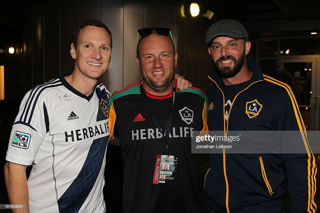 Clint Mathis (C) and guests attend the American Express VIP Game Experience With Landon Donovan at StubHub Center on September 21, 2013 in Los Angeles, California.