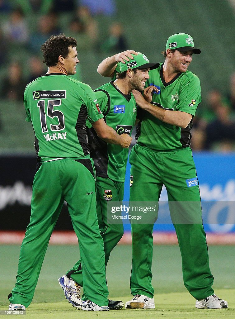 Clint McKay, Glenn Maxwell and John Hastings of the Melbourne Stars celebrate a wicket during the Big Bash League match between the Melbourne Stars and the Sydney Thunder at Melbourne Cricket Ground on January 8, 2013 in Melbourne, Australia.