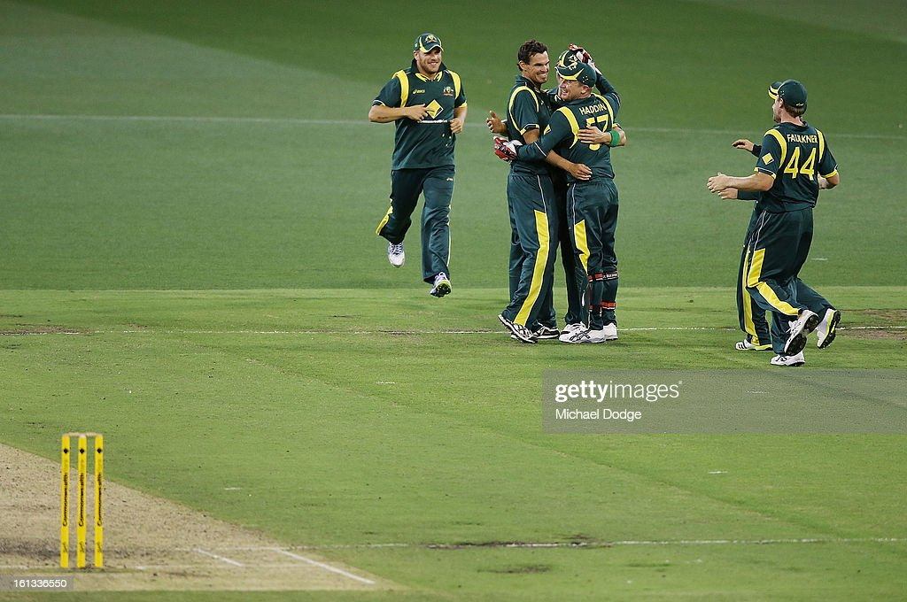 Clint McKay (2L) is hugged by keeper Brad Haddin as Australia celebrates their win their during game five of the Commonwealth Bank International Series between Australia and the West Indies at Melbourne Cricket Ground on February 10, 2013 in Melbourne, Australia.