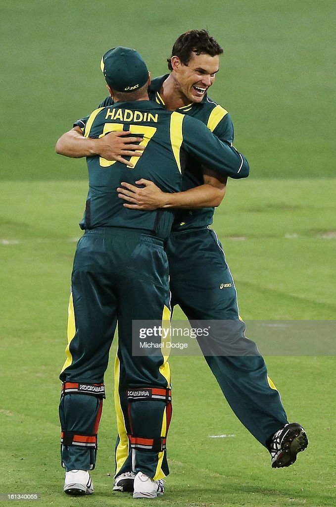 Clint McKay (R) is hugged by keeper Brad Haddin as Australia celebrates their win their during game five of the Commonwealth Bank International Series between Australia and the West Indies at Melbourne Cricket Ground on February 10, 2013 in Melbourne, Australia.