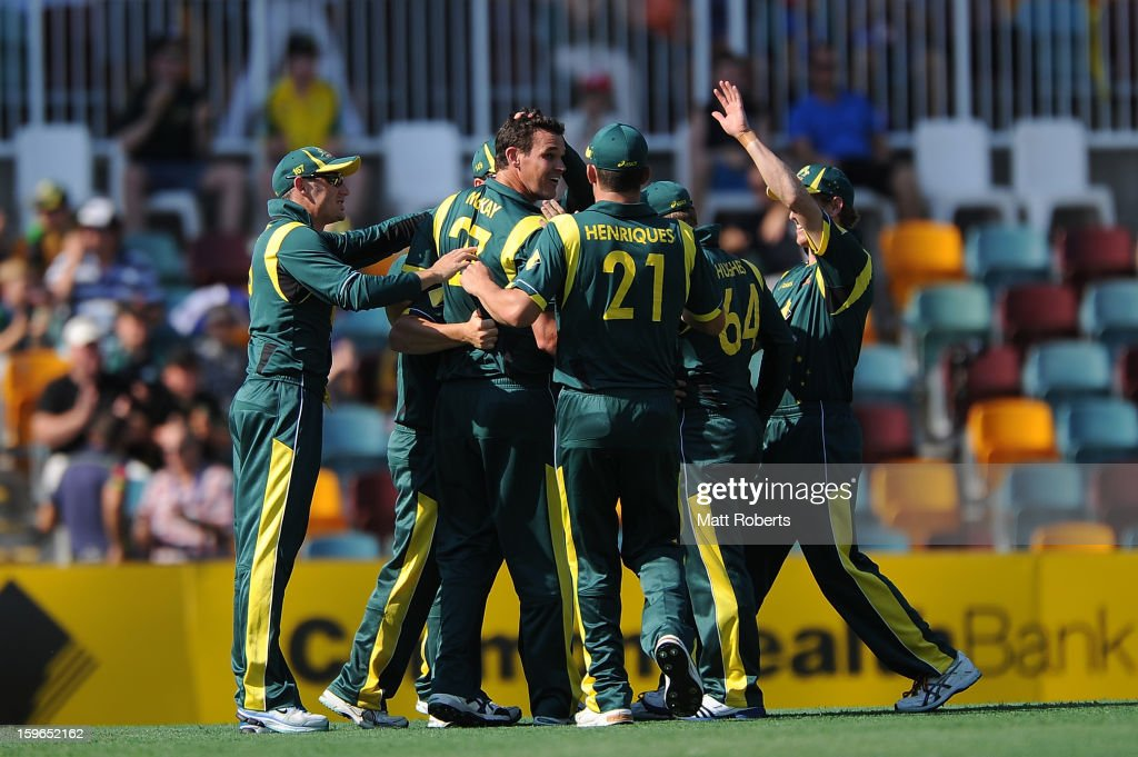 Clint McKay (C) of Australia celebrates a wicket with team mates during game three of the Commonwealth Bank one day international series between Australia and Sri Lanka at The Gabba on January 18, 2013 in Brisbane, Australia.