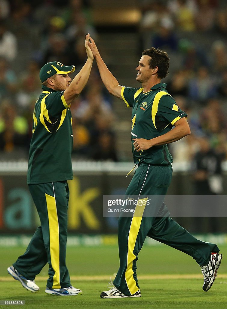 Clint McKay of Australia is congratulated by Aaron Finch after getting a wicket during game five of the Commonwealth Bank International Series between Australia and the West Indies at Melbourne Cricket Ground on February 10, 2013 in Melbourne, Australia.