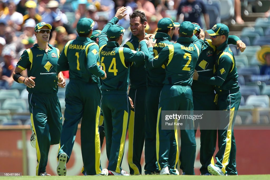<a gi-track='captionPersonalityLinkClicked' href=/galleries/search?phrase=Clint+McKay&family=editorial&specificpeople=4083690 ng-click='$event.stopPropagation()'>Clint McKay</a> of Australia is congratulated by team mates after dismissing Chris Gayle of the West Indies during game one of the Commonwealth Bank One Day International Series between Australia and the West Indies at WACA on February 1, 2013 in Perth, Australia.