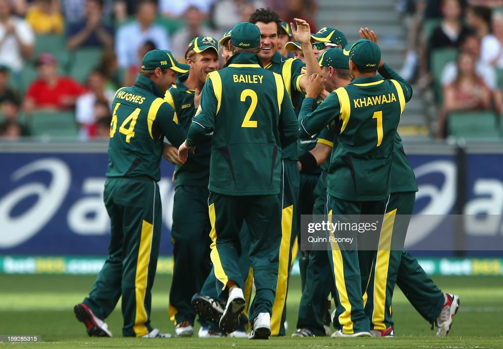 Clint McKay of Australia is congratulated by team mates after getting the wicket of Mahela Jayawardene of Sri Lanka during game one of the Commonwealth Bank One Day International series between Australia and Sri Lanka at the Melbourne Cricket Ground on January 11, 2013 in Melbourne, Australia.