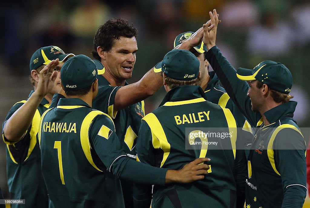 <a gi-track='captionPersonalityLinkClicked' href=/galleries/search?phrase=Clint+McKay&family=editorial&specificpeople=4083690 ng-click='$event.stopPropagation()'>Clint McKay</a> of Australia is congratulated by team mates after getting a wicket during game one of the Commonwealth Bank One Day International series between Australia and Sri Lanka at the Melbourne Cricket Ground on January 11, 2013 in Melbourne, Australia.