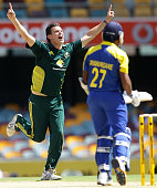 Clint McKay of Australia takes the wicket of Mahela Jayawardene of Sri Lanka during the Commonwealth Bank Series match between Australia and Sri...